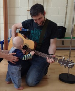 Ross and Isaac playing guitar