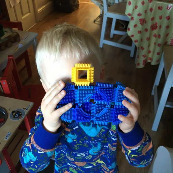 Isaac with a stickle brick camera